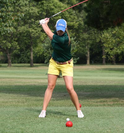 True to the Swing: Senior Morgan Reimler winds back for shot towards the fairway. Photo by Christopher Roberts.