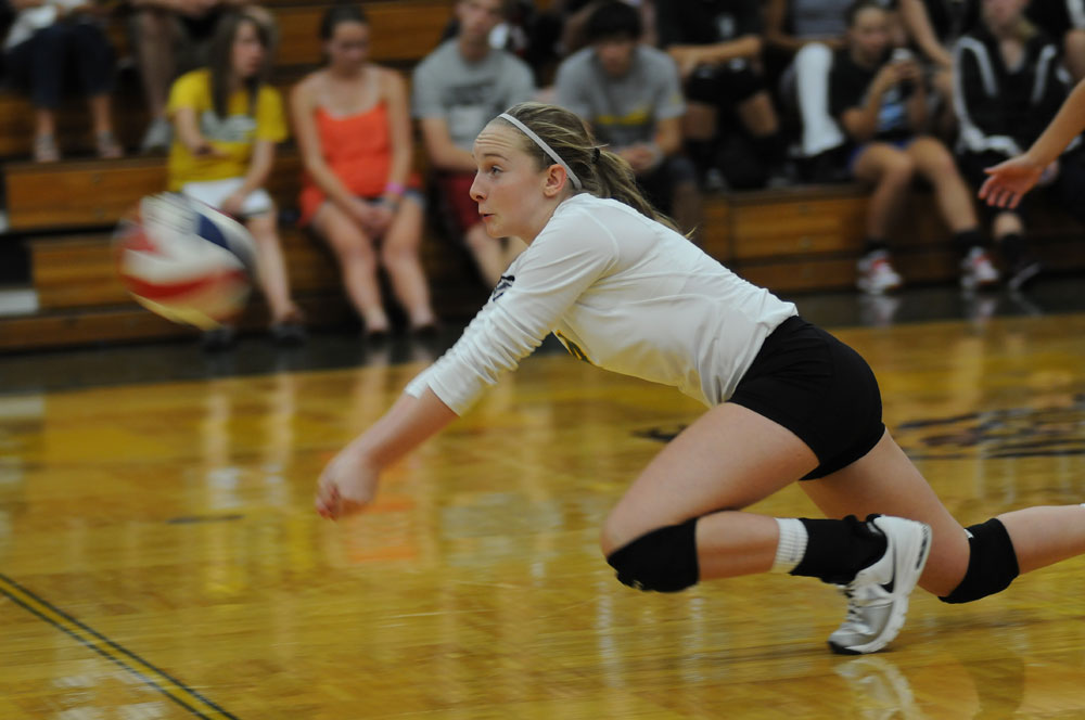 Senior Carly Offerdahl exhibits great effort as she sacrifices her body in a dive to save the ball.