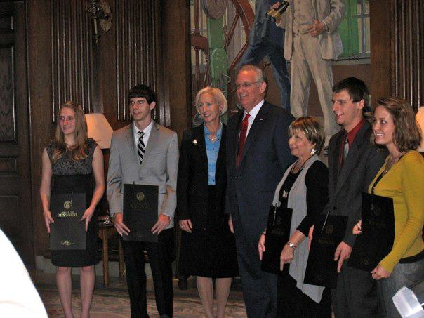 Juniors Haley Benson and Chandler Randol (left) pose with Governor Jay Nixon, his wife Georganne Wheeler Nixon and other state officials with the proclamation.