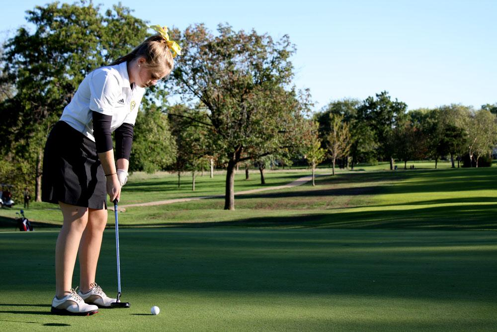 Sophomore Madison McDonnell sets up to putt in a match against Mexico at Lake of the Woods golf course. This was the last match of the season for both the varsity and JV teams. Photo by Aniqa Rahman.