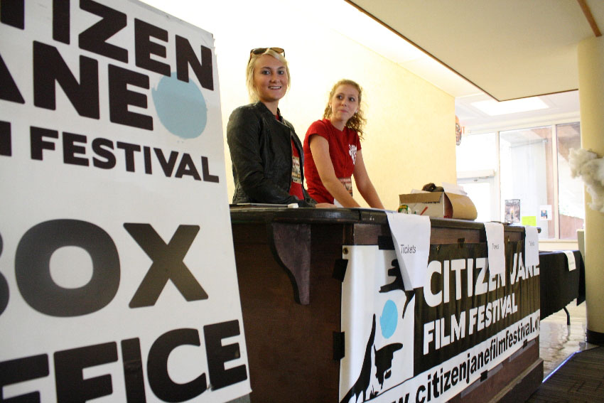 Seniors Carleigh Thrower and  Gracie Strawn work the Citizen Jane box office.