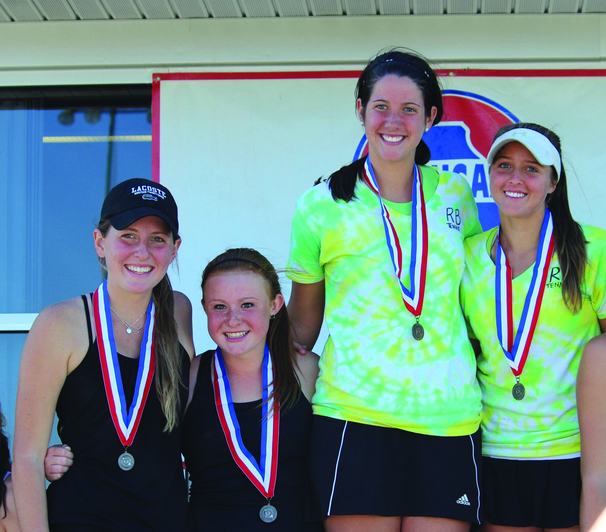 Racket-ing up points:  From left, senior Maddy Kayser, junior Allison Baker, sophomore Phoebe Boeschen and junior Sophi Farid competed in the state championship doubles match taking the first and second places overall, after each other. The team came in second overall.