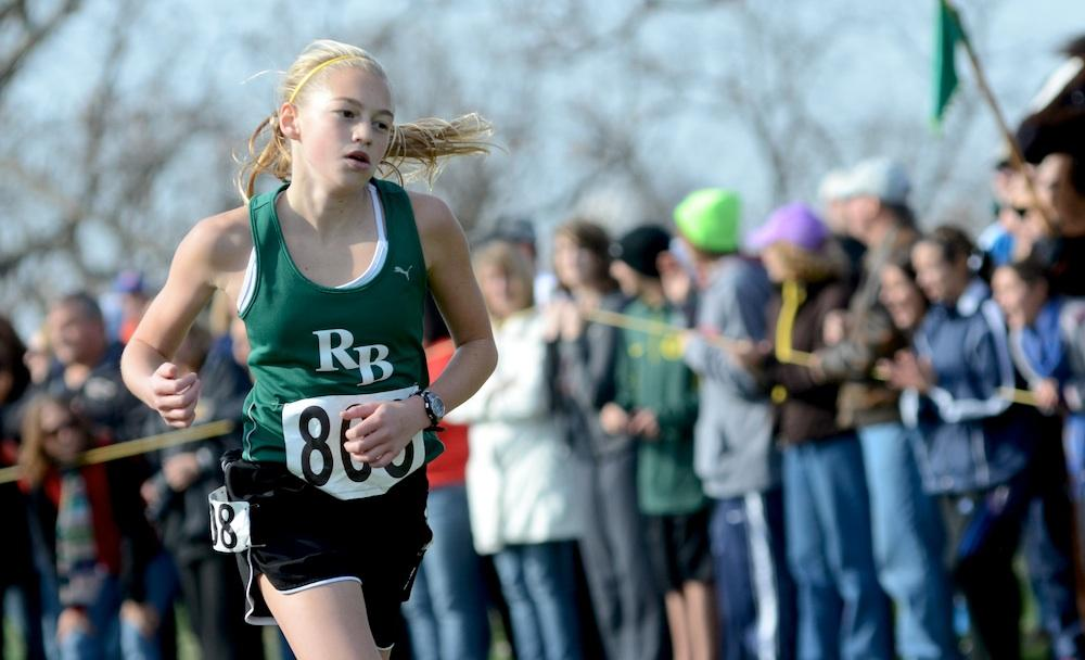 Emily Harl races the last hundred meters of her freshman cross country season at the MSHSAA State Championship meet on November 3. Photo by Asa Lory
