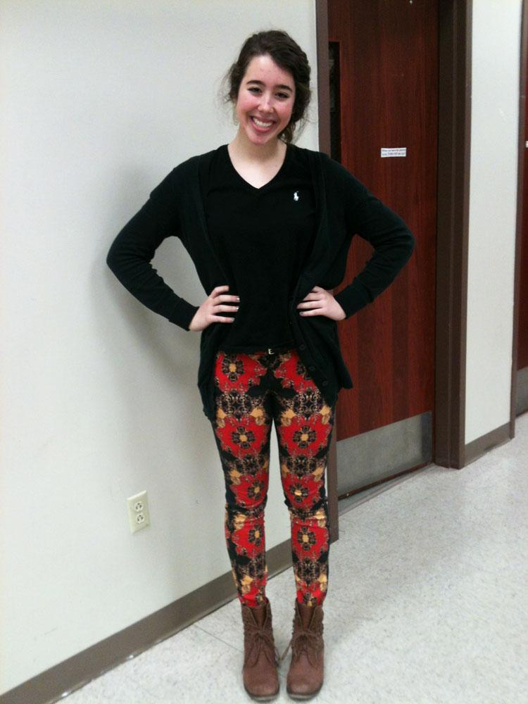 Junior Megan Kelly wears a black sweater with patterned skinny jeans and brown boots. Photo by Lauren Puckett