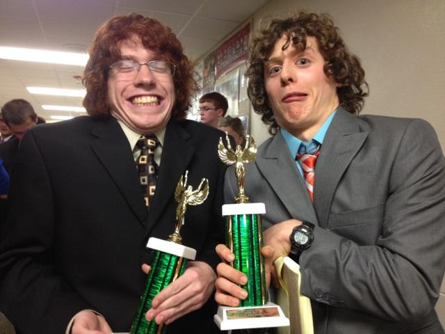 Senior Captains Andrew Hutchinson (left) and Stephen Turban (right) pose with their 3rd place trophies in Champ Public Forum Debate at the Clayton-Ladue Debate Tournament in November.