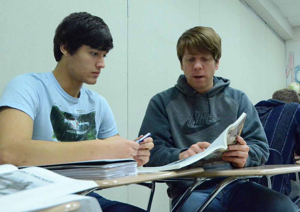 U.S. History teacher Dan Ware helps Senior Daniel Duerto decipher nationalities through questionable names.