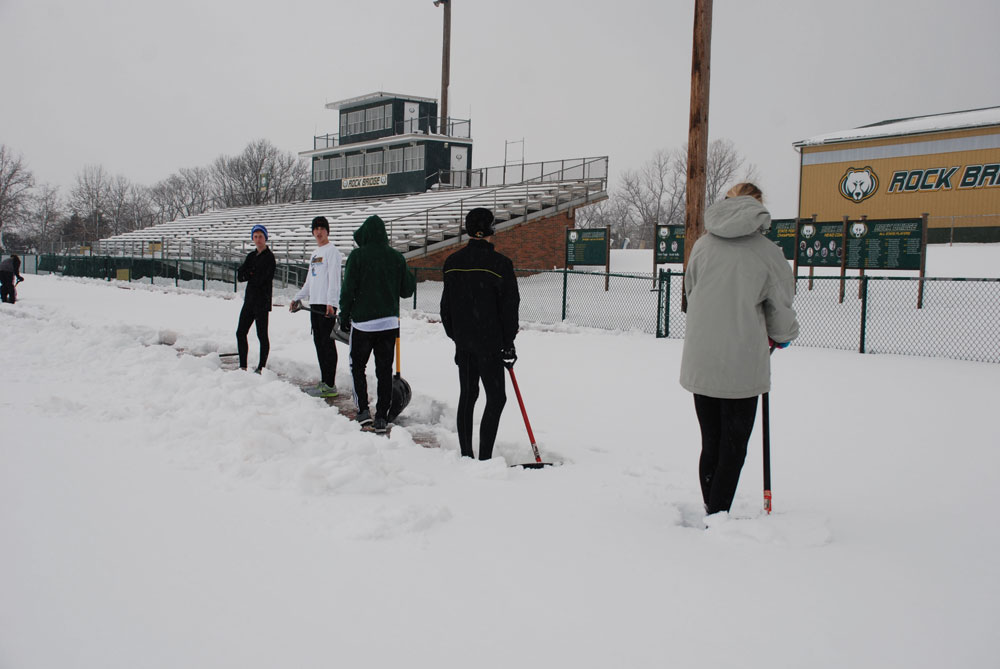 Digging deep: Members of RBHS track team shovel the blanket of snow that covered the track outside the school. Photo provided by Annette Schulte
