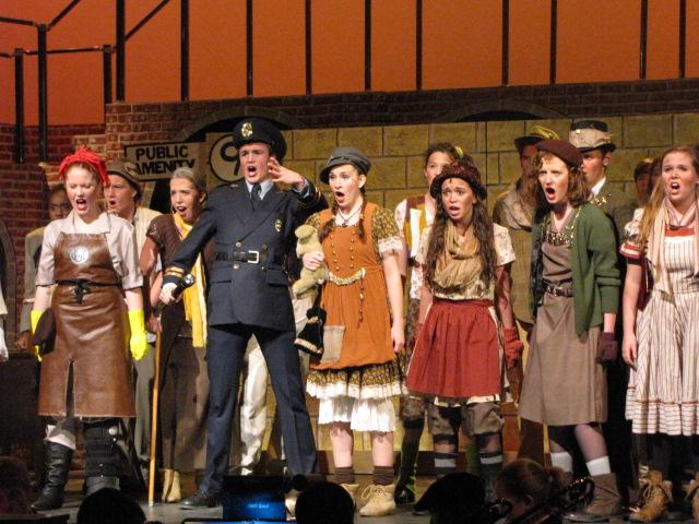 Troy Guthrie performs in a scene from Urinetown.