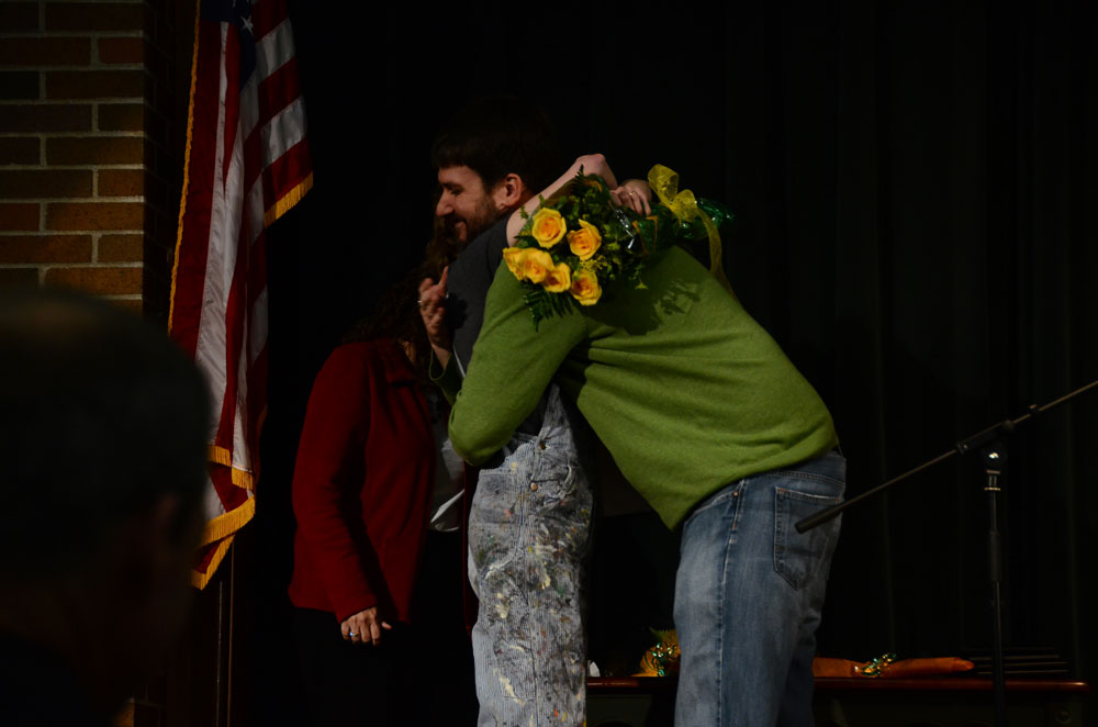 Mary Margaret Coffield receives a hug from Jim Meyers. Coffield had just learned she was the teacher of the year for RBHS. Photo by Mikaela Acton