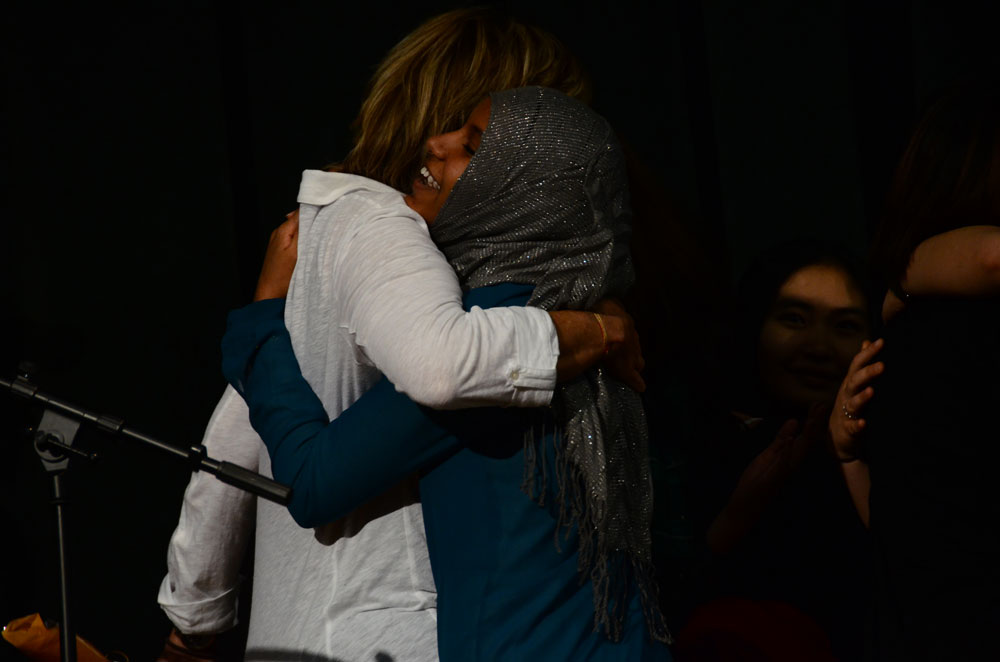 English Language Learner teacher Peggy White receives a hug after her students give her a Bruin of my Life award. Photo by Mikaela Acton