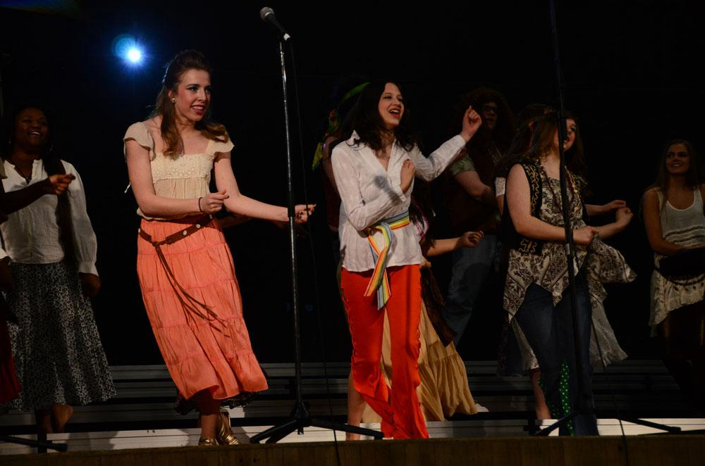 """Students from the cast of """"Hair"""" perform at the Flashback assembly. The Theatrical Showcase runs May 3 and May 4. Photo by Mikaela Acton"""
