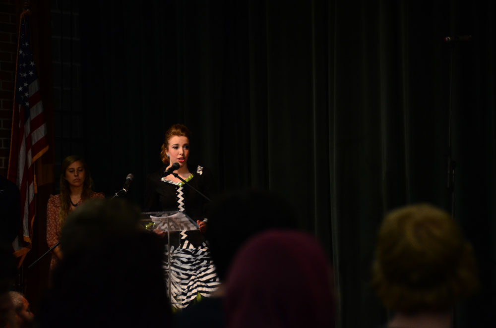 Senior Lauren Puckett sings the National Anthem to open the Flashback assembly. Photo by Mikaela Acton