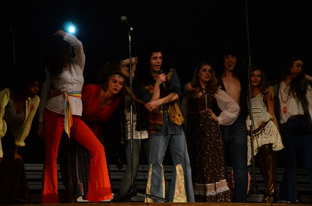 """Members of the cast of """"Hair"""" perform at the Flashback assembly. Photo by Mikaela Acton"""