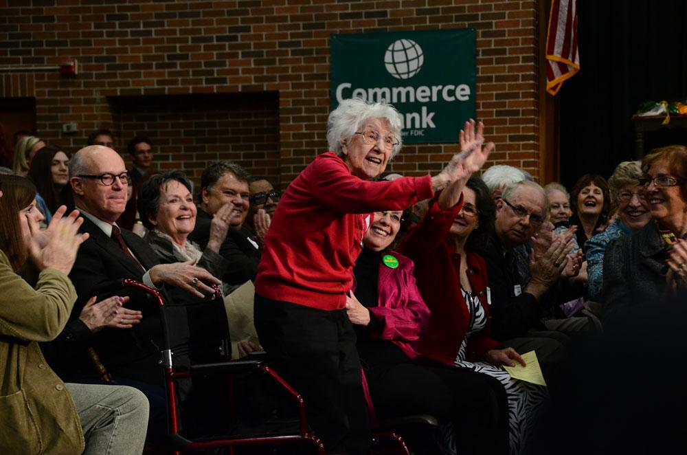 Eileen Ford, one of the first English teachers at Rock Bridge High school, responds to applause. Faculty and students from the first 40 years of the school came to the Flashback assembly. Photo by Mikaela Acton