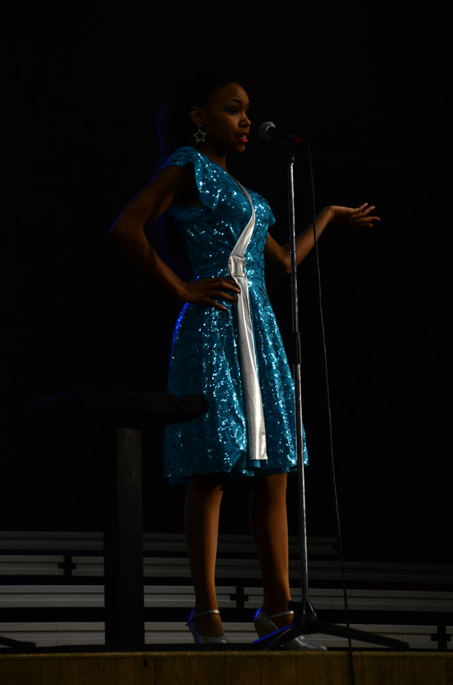A member of Satin 'n' Lace, Titiana Aerozaga performs a solo during the group's song. Photo by Mikaela Acton