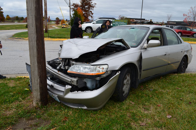 The car involved in the accident underwent serious damage after hitting a light post in the RBHS parking lot.