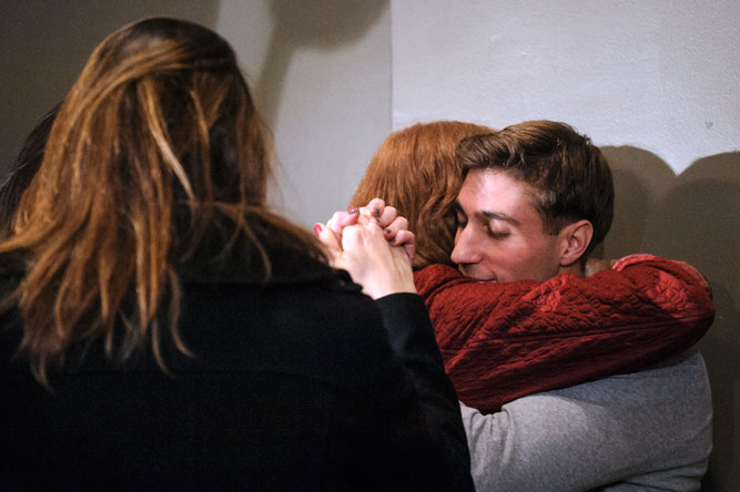 After nine years in prison as a convicted murderer, Ferguson hugs his mother at a news conference Nov. 12, 2013, one week after the appellate court overturned his conviction.