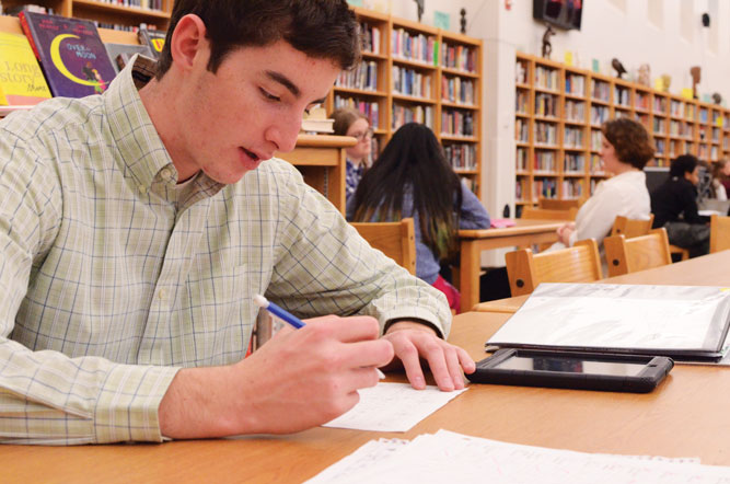 Study Time: Senior Jake Gallagher studies in the media center on Tuesday, Dec. 10. Finals week begins next Monday, Dec. 16.