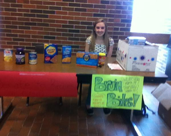 sophomore Rebekah Busick collected food in the main commons on Wednesday for the Bruin Bites food drive. Students are encouraged to donate nonperishables in order to provide for other members of the RBHS community.