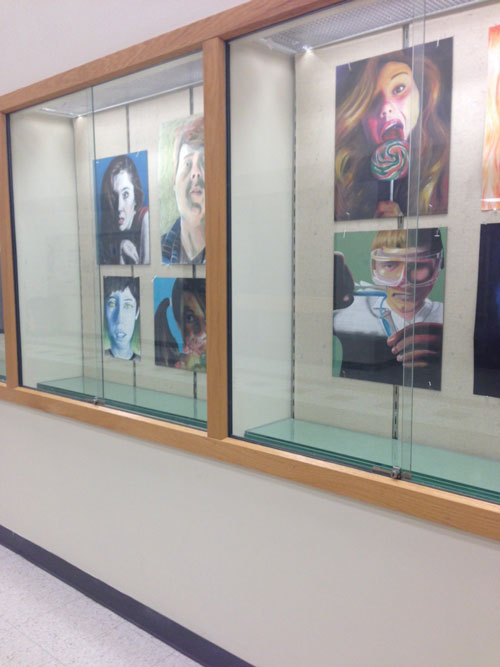 Showcasing talent: RBHS students' art hangs in a display case near the main office. Some of their art will be shown on Sunday. Photo by Sophie Whyte