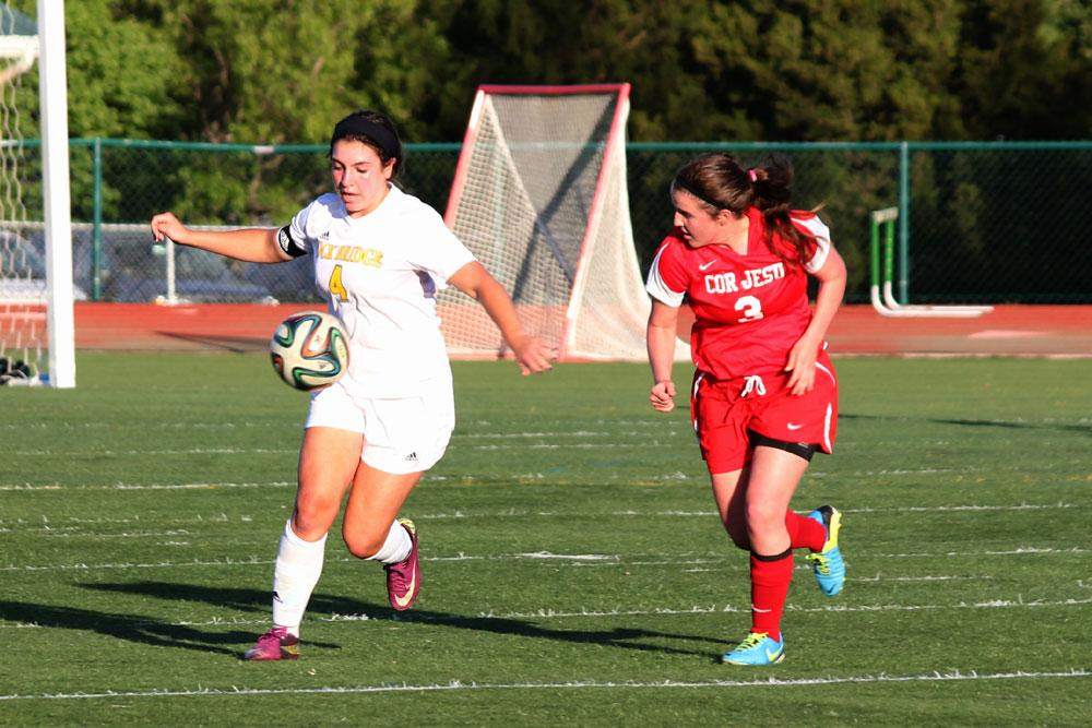 Staying ahead of her opponent, senior Laurie Frew moves down the field. Bruins lost to Cor Jesu 1-3 during the Varsity girls soccer game, May 9.  Photo by Amy Blevins