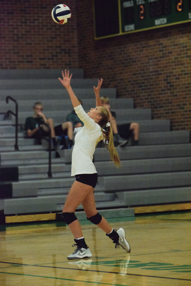 Sophomore Abby Green prepares to serve the ball against the Jefferson City Jays. The Bruins went on to win the game 2-0. RBHS looks to hold their own in tonight's match against the Helias Catholic Crusaders. Photo Credit to Abby Blitz