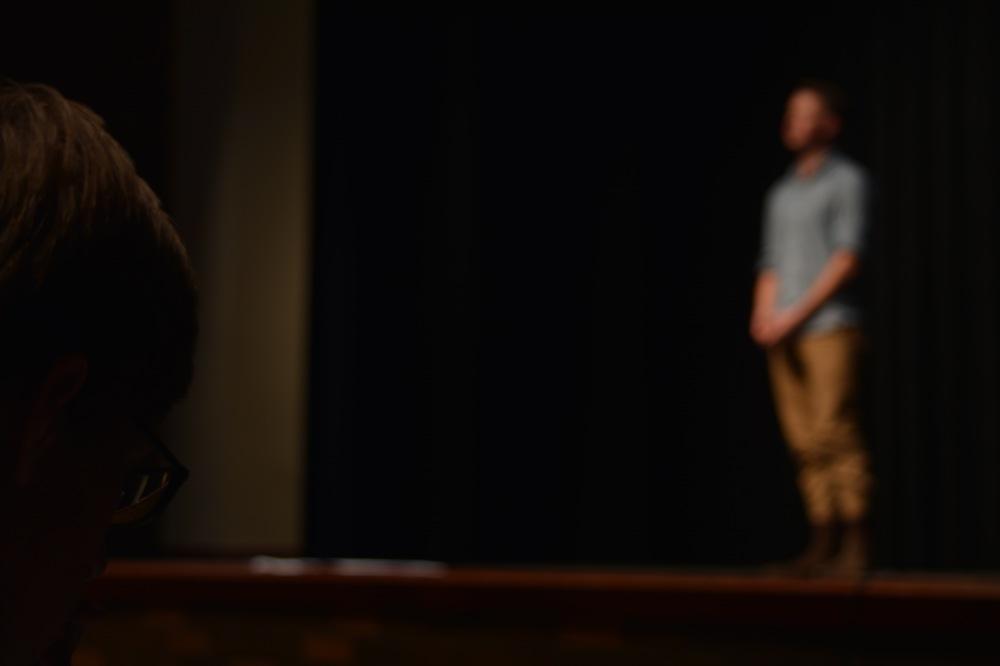 Senior Zach Reichert watches auditions.