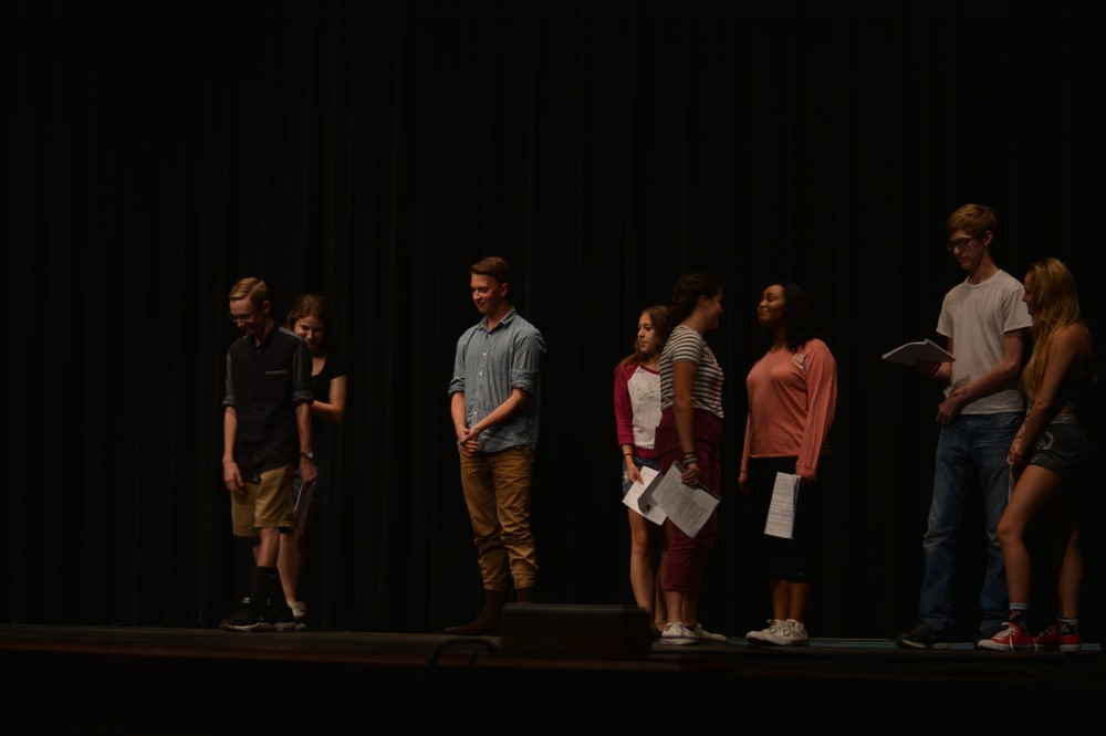 The auditionees on stage are told the rules for auditioning by the two judges.