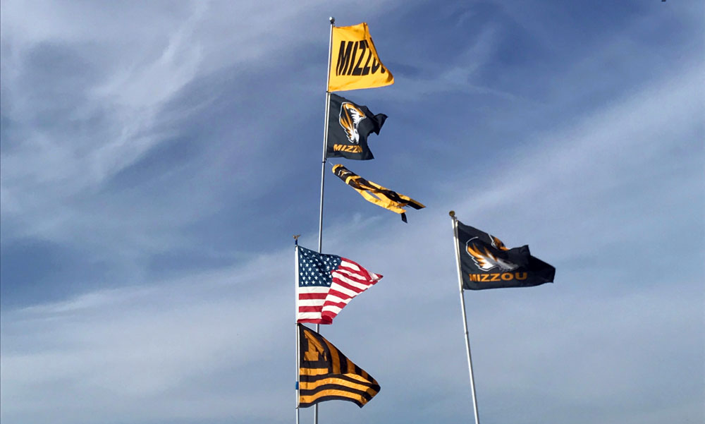 Flags wave at a Missouri Tiger's tailgate. Photo by Cassidy Viox
