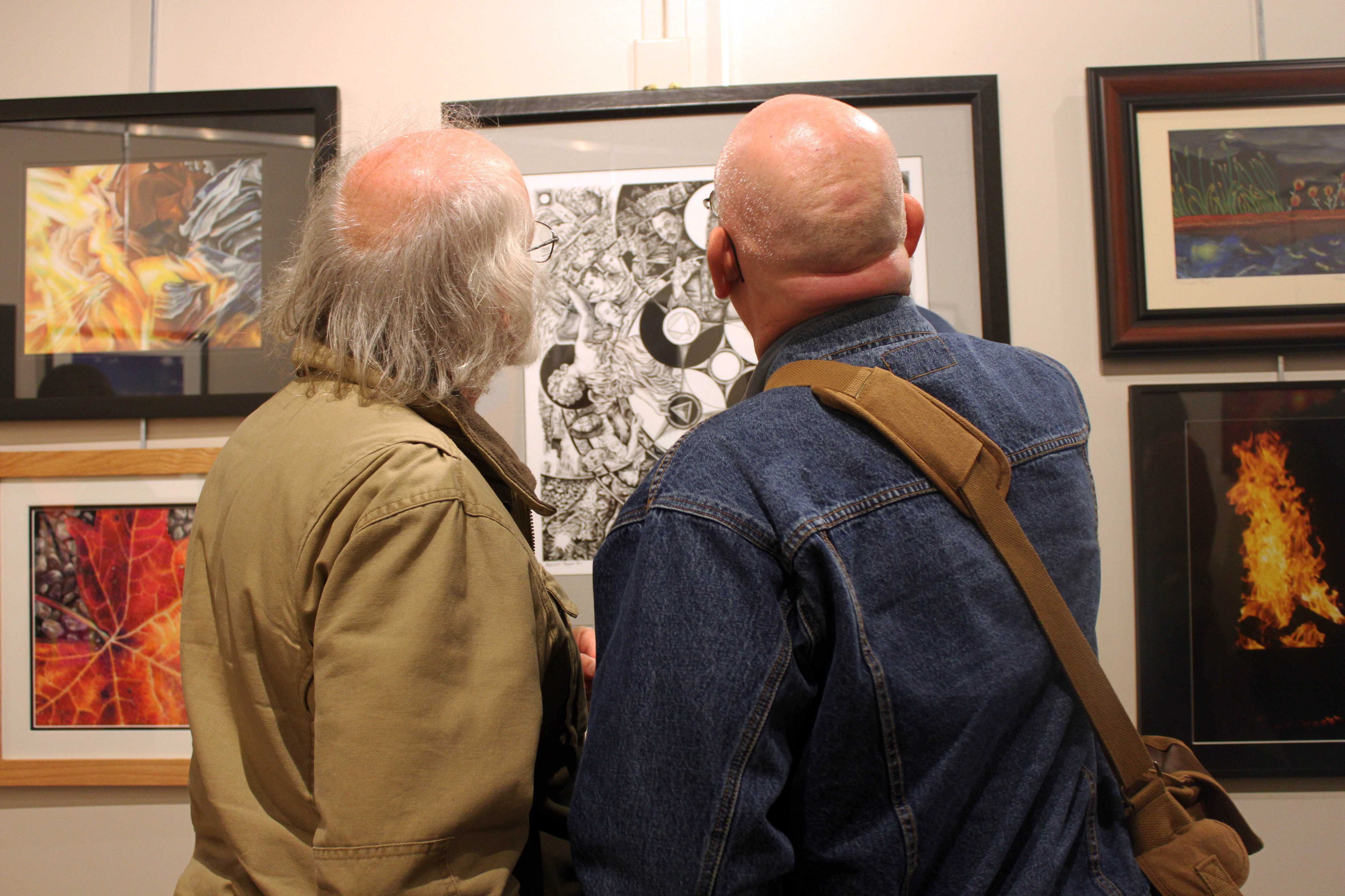The Missouri Theater is connected to the Columbia Art League, allowing attendees to enjoy artworks from local artists while savoring their food and drink.