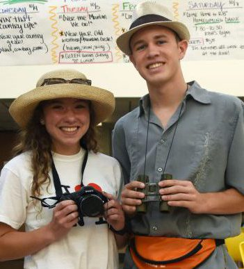 """Seniors Dalton Nunamaker and Caroline Stevens take a break from their """"sightseeing"""" on the first day of homecoming's """"road trip"""" theme."""