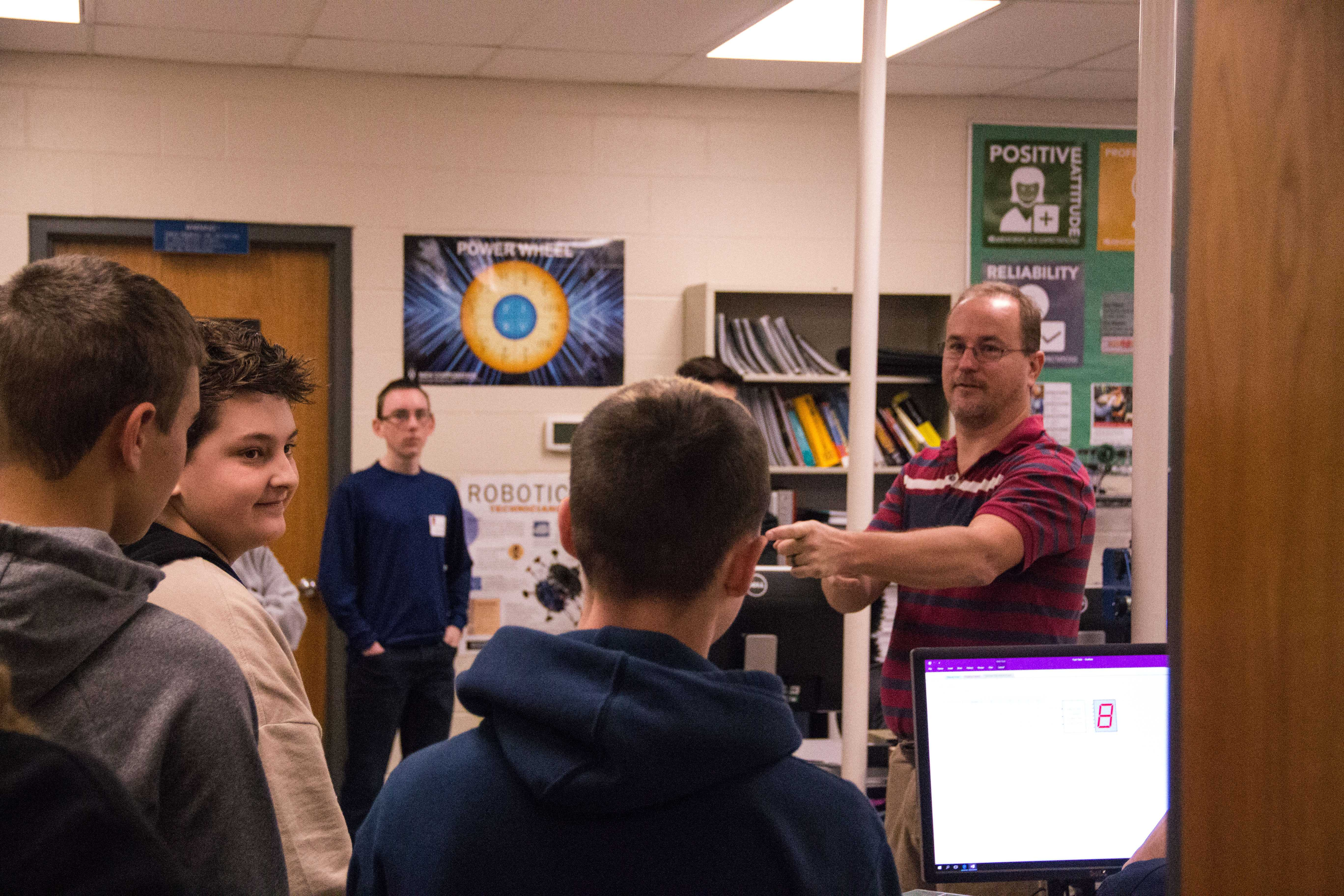 Students listen in on a demonstration in the Columbia Area Career Center (CACC).
