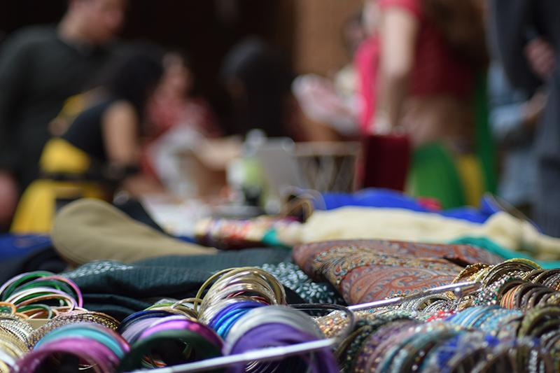Many booths displayed traditional outfits and accessories. such as decorative bangles from India. Photo by Allie Pigg.