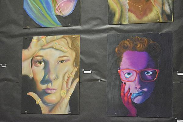 Many artists entered self-portraits, including these from juniors Mariah Blackburn and Quinn Converse.
