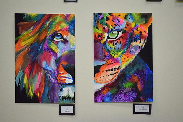 "Two pieces titled ""Cats"" positioned next to each other. One by sophomore Toan Vu and the other by sophomore Kate Bushnell"
