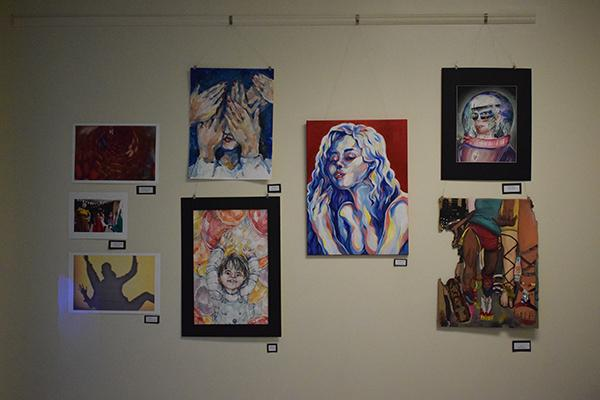 The walls throughout the main hallway were filled with different styles of art from many different students.