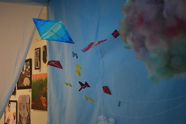 Handmade, paper kites seemed to fly around guests as they entered the art show.