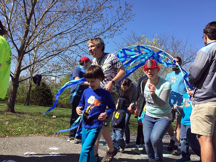 Children and their parents begin the 1.2 mile walk.