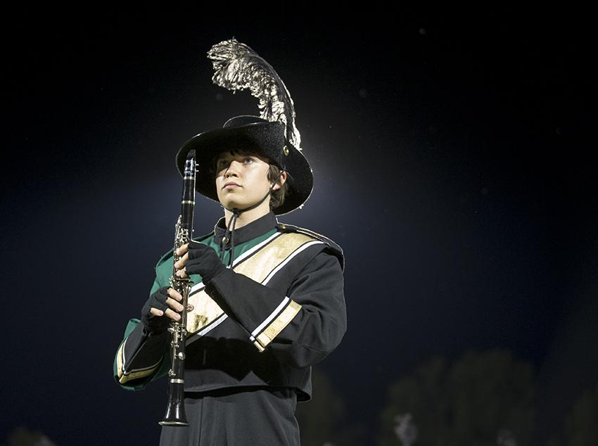 "Freshman clarinetist Andrew Morgan patiently waits for his cue to play during the Emerald Regiment marching band's mesmerizing halftime performance. This years show is called ""When the Clock Strikes Twelve."" The repertoire includes Camille Saint-Saëns' classically haunting Danse Macabre. Photo by Maya Bell."