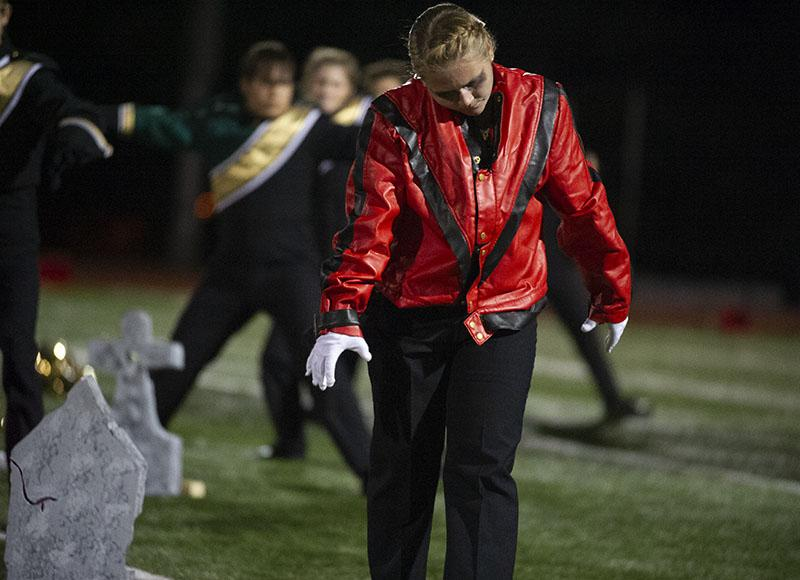 Junior drum major Shanley Silvey performs Michael Jackson's Thriller during the bands half-time performance.