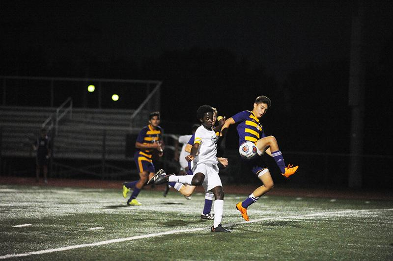 Nene challenges a HHS defender heading towards the goal. Although a defender himself, Nene found himself in an attacking positions several times throughout the game. The Bruins are versatile in how their positions , adding to the complexity of the team's play.