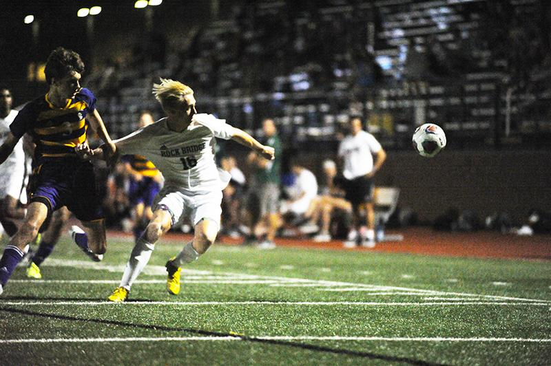 Durdle pushes off a Kewpie  defender during the second half. Durdle had several shot attempts and set play chances throughout the game. He still, however. left the game scoreless.