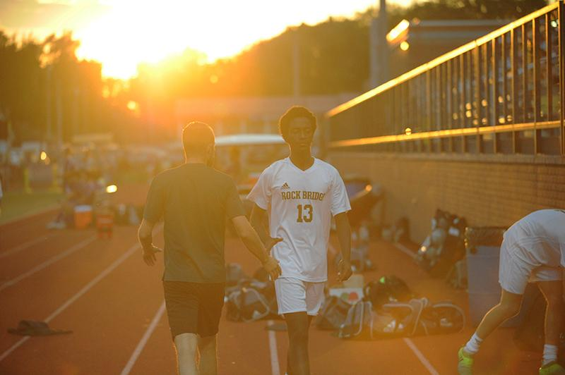 In the light of the setting sun, Nene high fives Assistant Coach Topher Hortsman before taking the field. Nene and his teammates pushed many plays towards their goal during the game. Despite their efforts, the Bruins failed to find the back of the net.