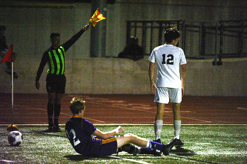 At the demand of the side referee, sophomore Lucas Godon stops his play at the corner. Godon was called for a foul while trying to steal the ball from a Kewpie defender. The Bruins had many plays develop in the corners near their goal but few of them found their way into the middle.