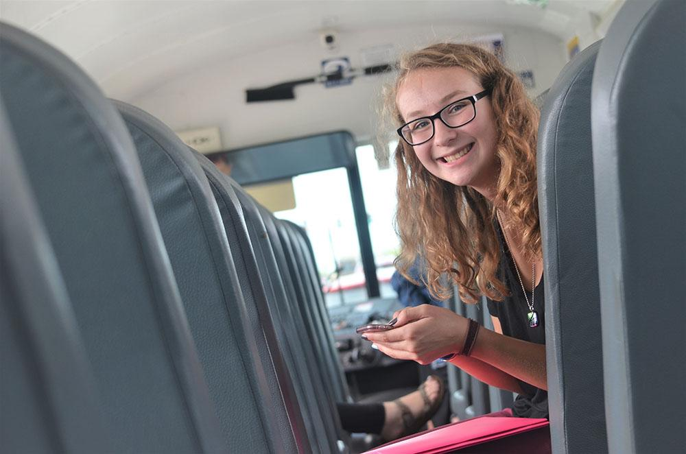 Sophomore Jacque Drown sits on the bus along with her classmates as they near the school. Drown is returning from a field trip to Lenoir Woods Retirement Home with her Teaching Professions class. Photo by Sarah Mosteller.