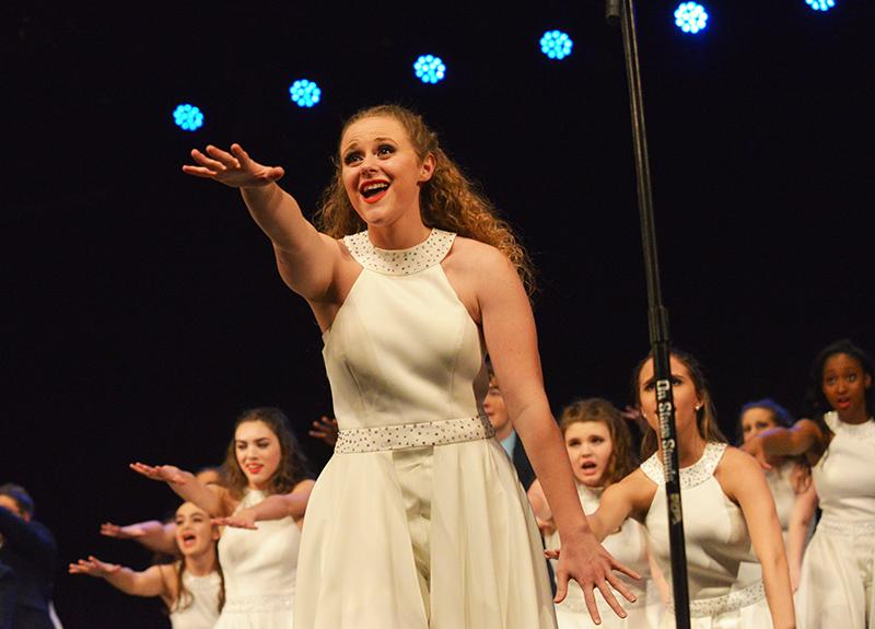 Senior Battalion member Gracie Jones rises her arm to the beat of the music, leading her choir behind her. The Battalion performance varied in emotion from an upbeat and lively tone to a serious, heartwarming song about the importance of life.