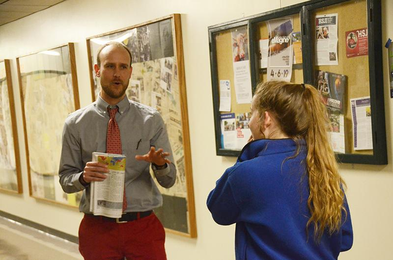 RBHS' incoming Principal, Jacob Sirna, speaks with junior Audrey Snyder in the hallway Thursday, March 14. Photo by Allie Pigg.