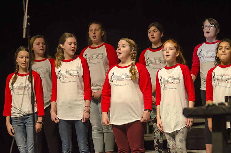 Jefferson Middle School (JMS) singers raise their voices in song in rehearsal for the fifth grade extravaganza. The JMS choir is a club that meets after school.
