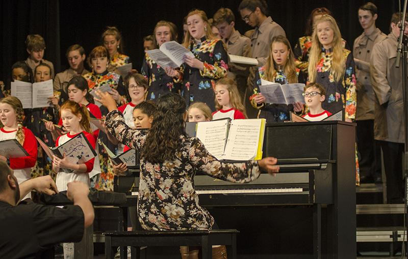 JMS choir teacher Christine Nichols leads JMS and RBHS in song. The two choirs sang two songs together before the fifth graders arrived.