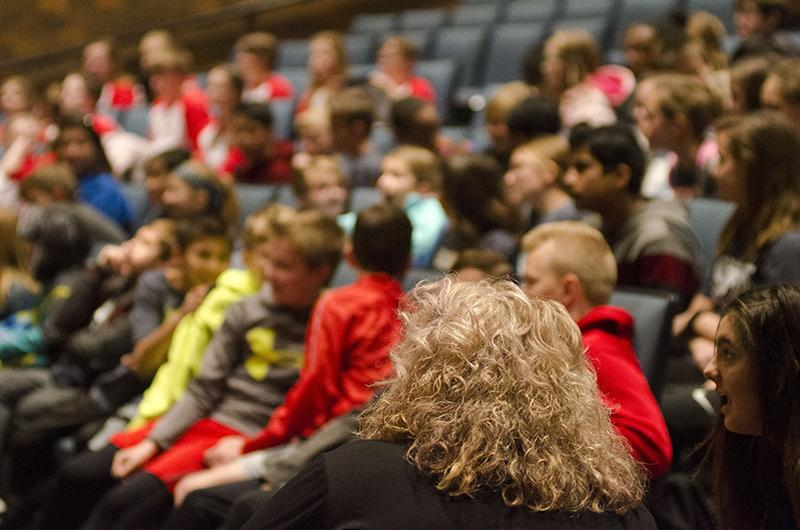 Gentry Middle School (GMS) music teacher Darla Lenz looks up at the stage with her students. GMS and JMS, RBHS' two feeding middle schools, both brought choirs to the extravaganza.